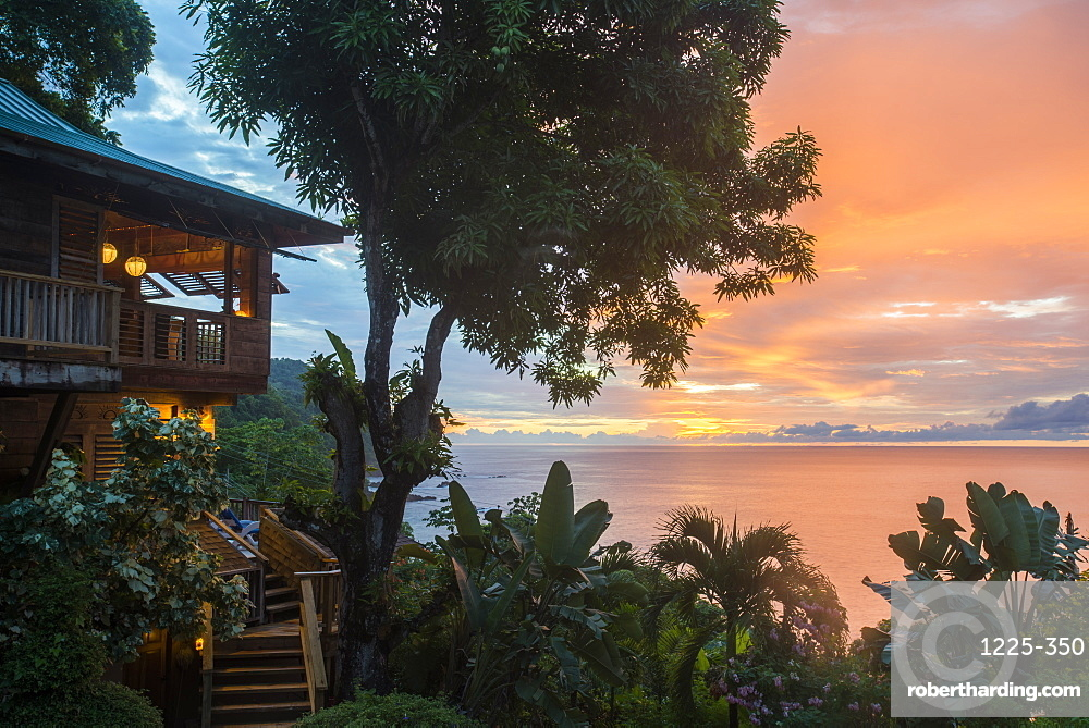 A tree house style apartment in the rainforest faces out to sea at sunset in Castara Bay in Tobago, Trinidad and Tobago, West Indies, Caribbean, Central America