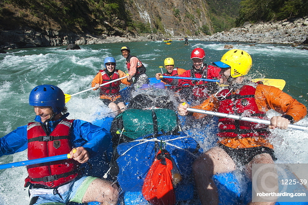 Rafters get splashed as they go through some big rapids on the Karnali River in Nepal, Asia