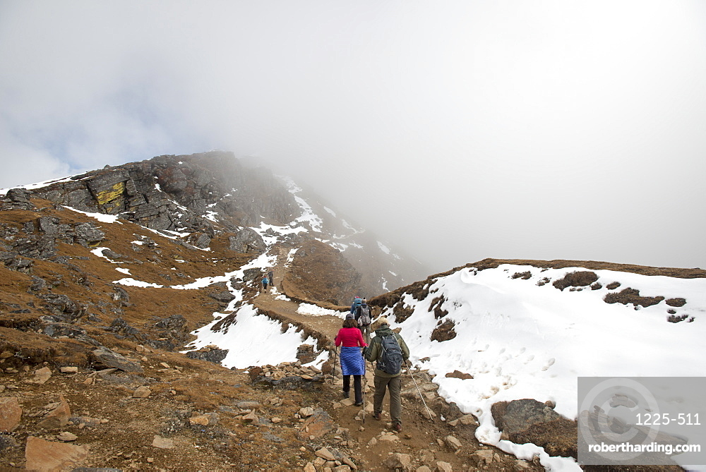 Hiking in the mist on the trail between Sian Gompa and Gosainkund in the Langtang region, Himalayas, Nepal, Asia