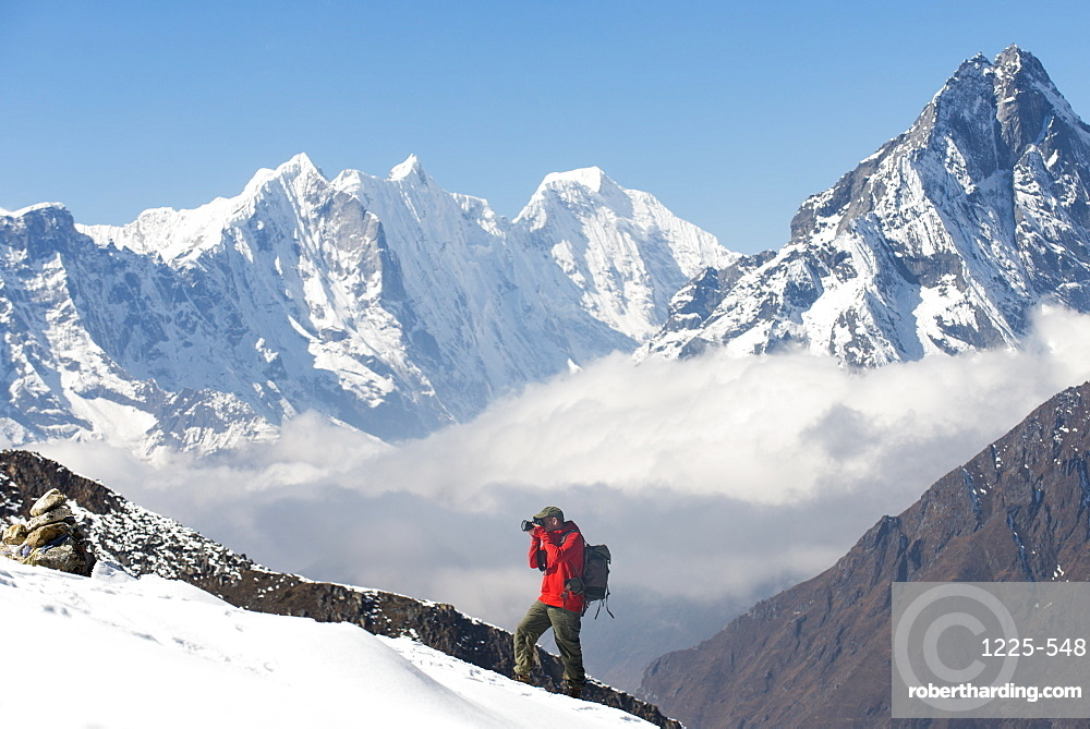 A photographer working in the Everest region of the Nepal Himalayas, Khumbu Region, Nepal, Asia