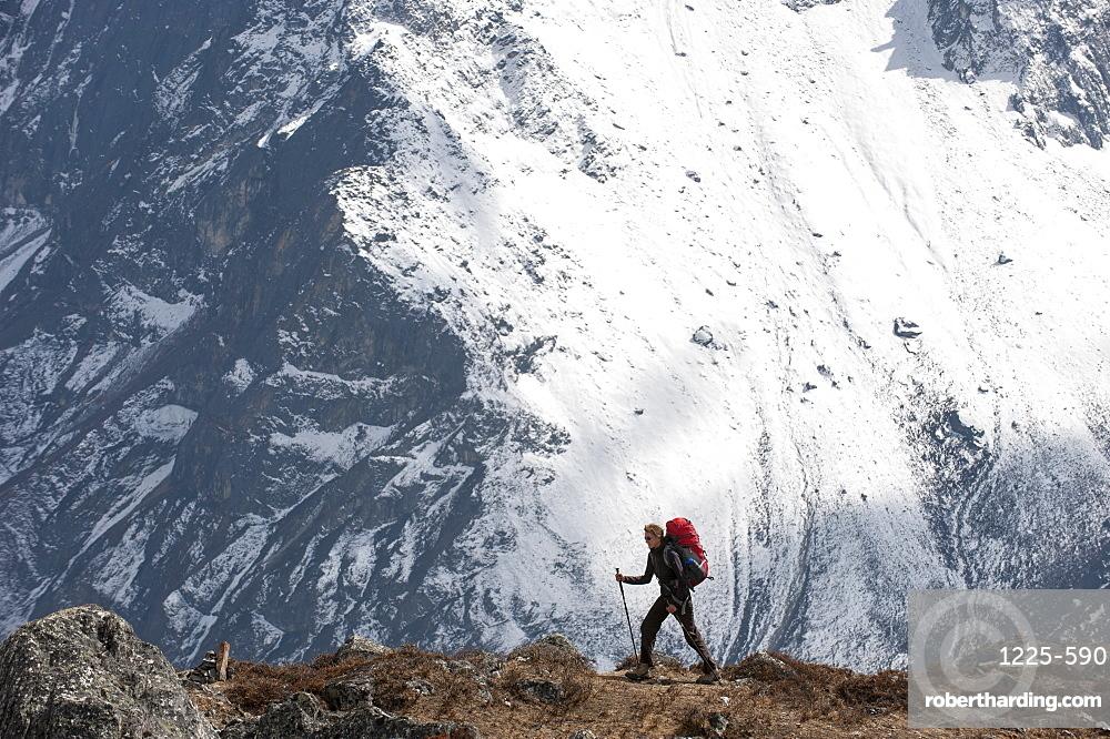 A trekker makes her way to Everest Base Camp, Khumbu Region, Himalayas, Nepal, Asia