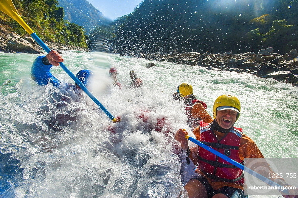 Rafters get splashed as they go through some big rapids on the Karnali River, west Nepal, Asia