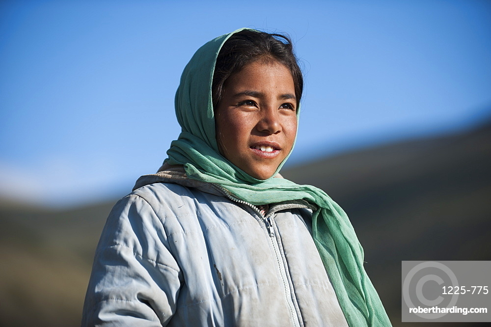 A nomad girl smiles as her father comes home from the hills, Ladakh, India, Asia