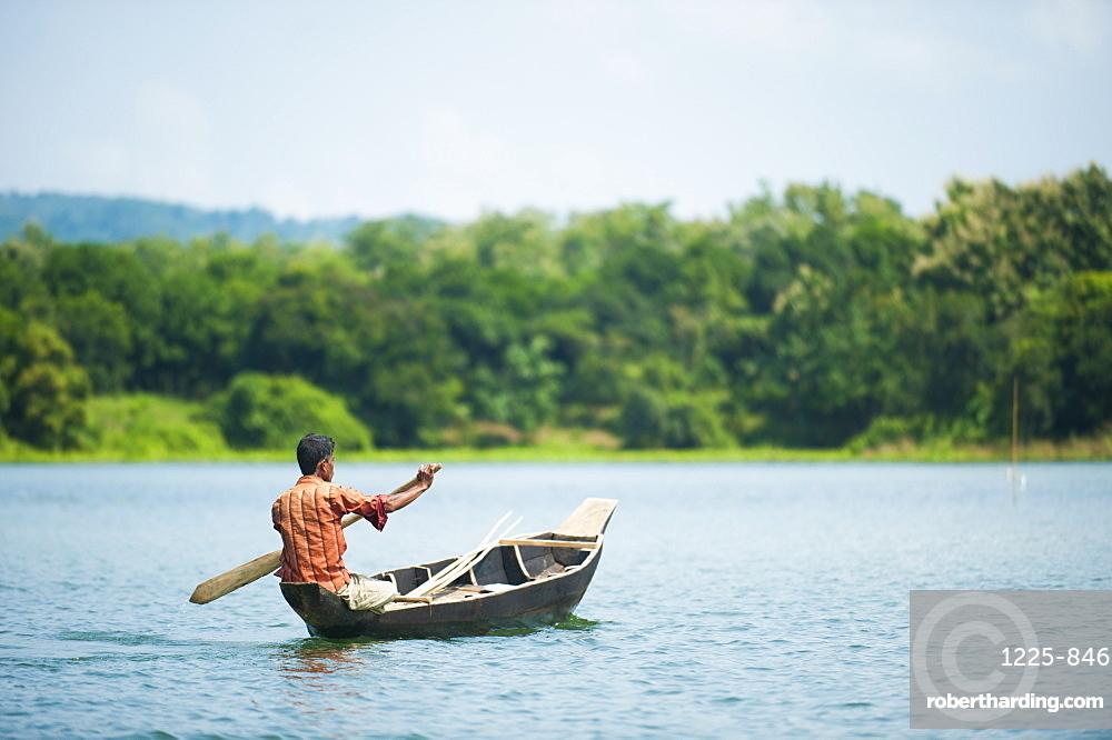 A fisherman on Kaptai Lake in the Chittagong Hill Tracts, Bangladesh, Asia
