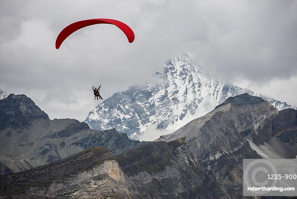 Paragliding in the Swiss Alps near Zermatt, Valais, Switzerland, Europe