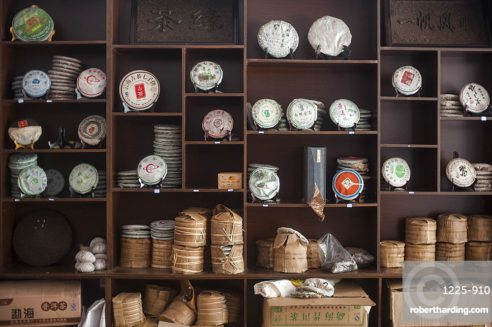 Tea cakes stacked up on shelves in a shop, Xishuangbanna, Yunnan Province, China, Asia