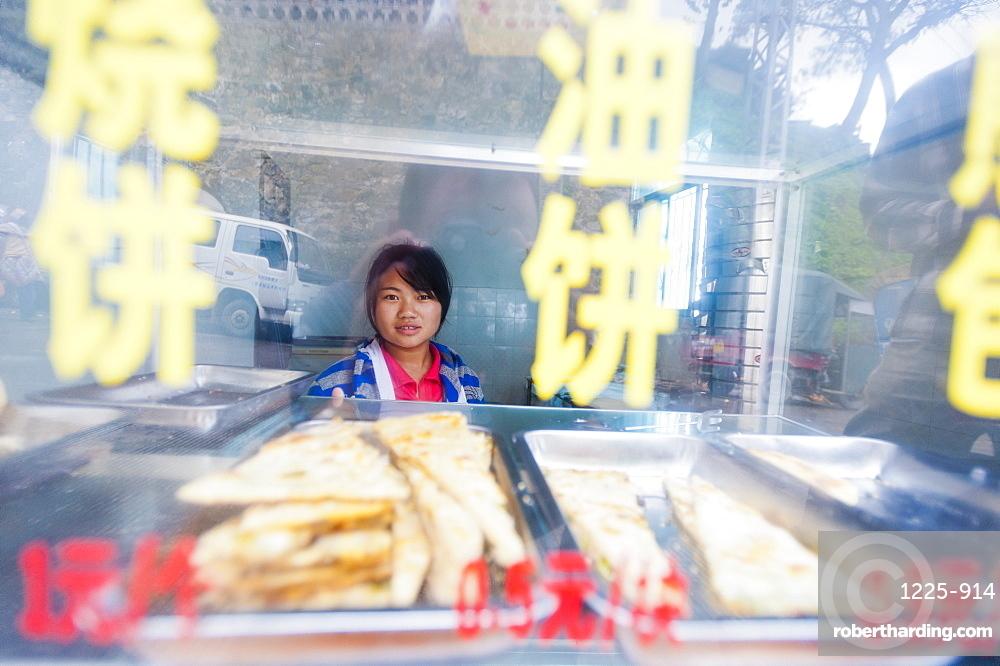 A girl in a shop in Yuanyang, Yunnan Province, China, Asia