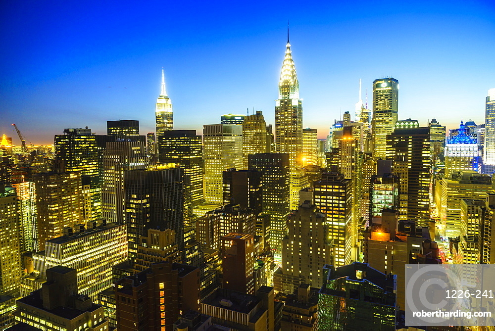 The Empire State and Chrysler buildings, Manhattan skyline at dusk, New York City, United States of America, North America