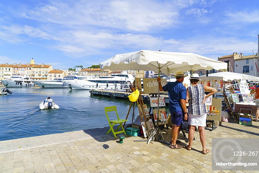 Art for sale by the harbour, Saint Tropez, Var, Cote d'Azur, Provence, French Riviera, France, Mediterranean, Europe