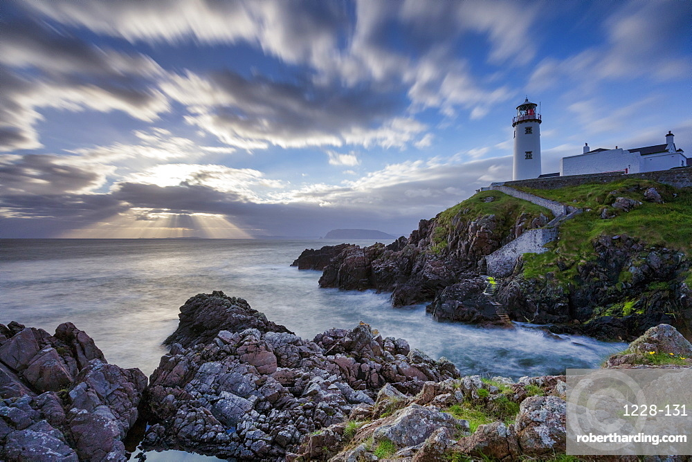 Sunrise over the Atlantic Ocean and Fanad Head Lighthouse in County Donegal, Ulster, Republic of Ireland, Europe