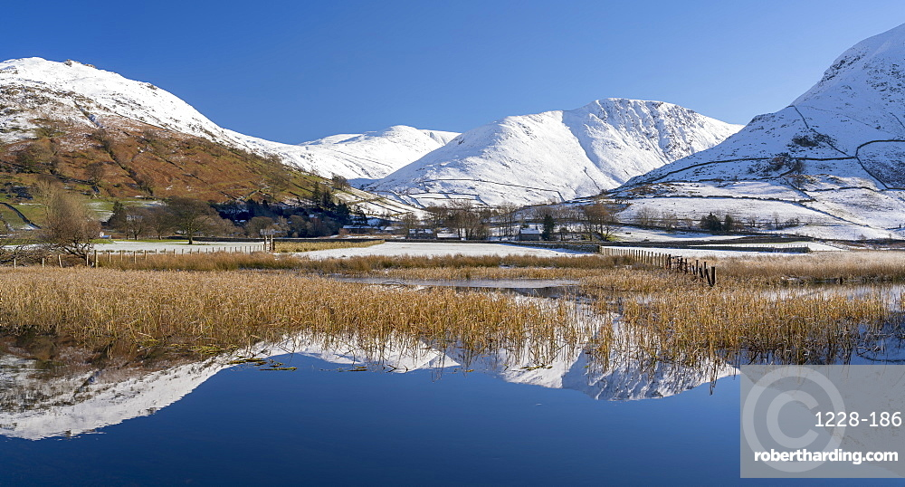 Snowclad sunlit fells around Hartstop reflected in Brothers Water, Lake District National Park, UNESCO World Heritage Site, Cumbria, England, United Kingdom, Europe