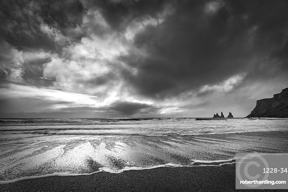 Sea stacks, tall cliffs and black basalt sandy beach at Vic on the southern coast, Iceland, Polar Regions