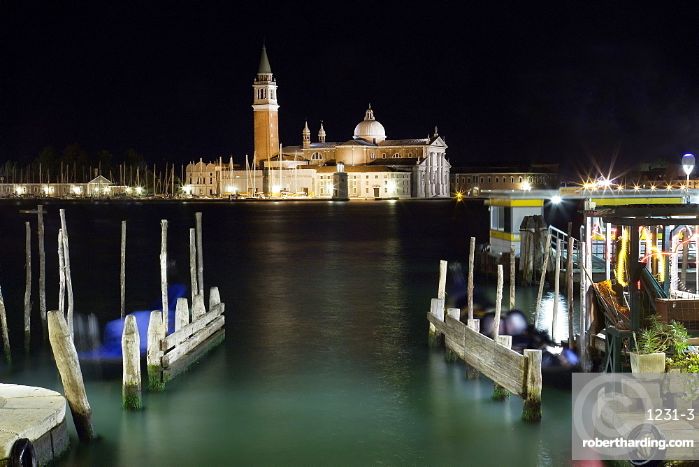 The island and church of San Georgio Maggiore at night with a boat dock in the foreground, Venice, UNESCO World Heritage Site, Veneto, Italy, Europe