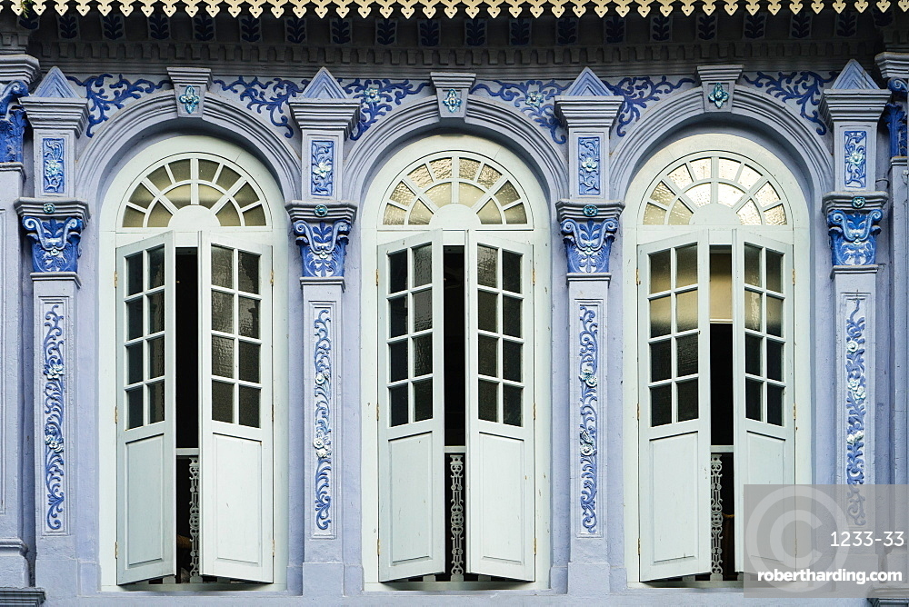 Traditional shophouse windows open out onto a street in the Orchard Road neighborhood in Singapore, Southeast Asia, Asia