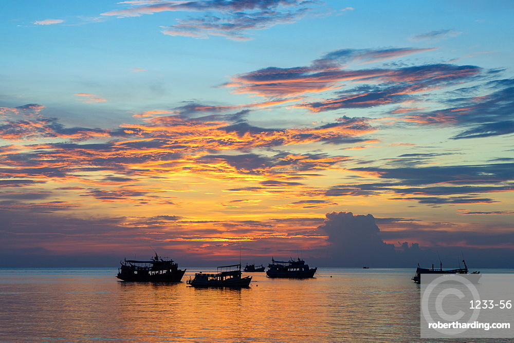 Sun sets over scuba diving boats in Koh Tao, Thailand, Southeast Asia, Asia