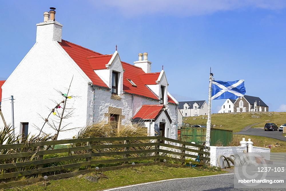 House with Saltire Flag, Isle of Eriskay, Outer Hebrides, Scotland, United Kingdom, Europe