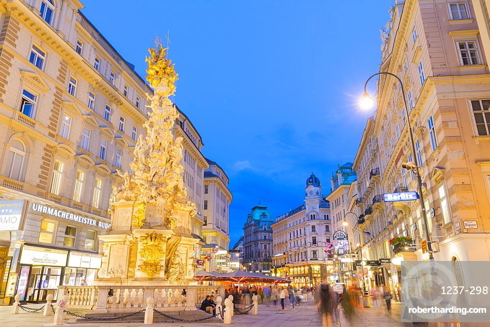 Pestsaule, (Plague Column) at dusk , Graben Street, Vienna, Austria.