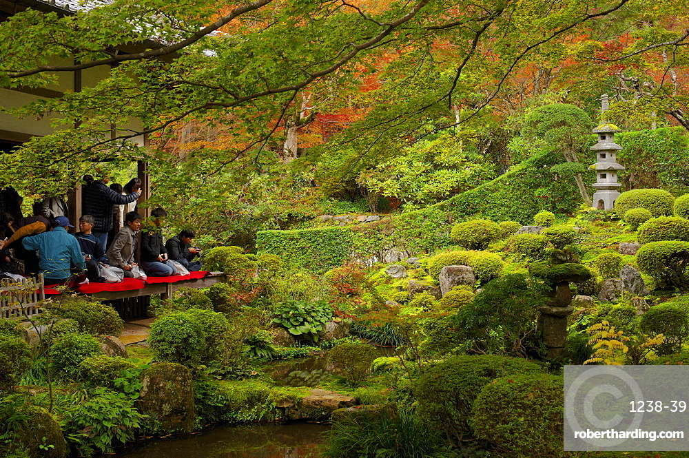 Tourists enjoying early autumn colours in Sanzen-in Temple, Kyoto, Japan, Asia