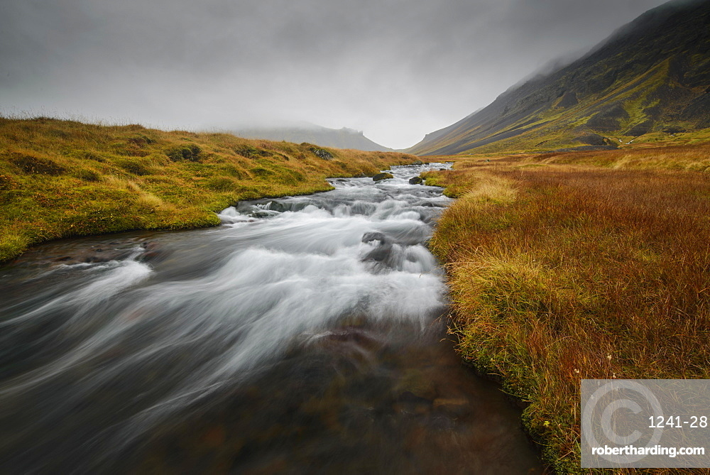 Snaefellsness, National Park, Glacial river flowing through mossy tundra, Iceland, Polar Regions