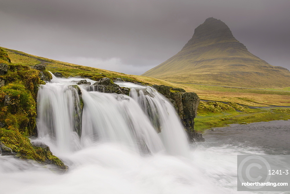 Kirkjufellsfoss on a cloudy day on the Snaefellsness Peninsula, Iceland, Polar Regions
