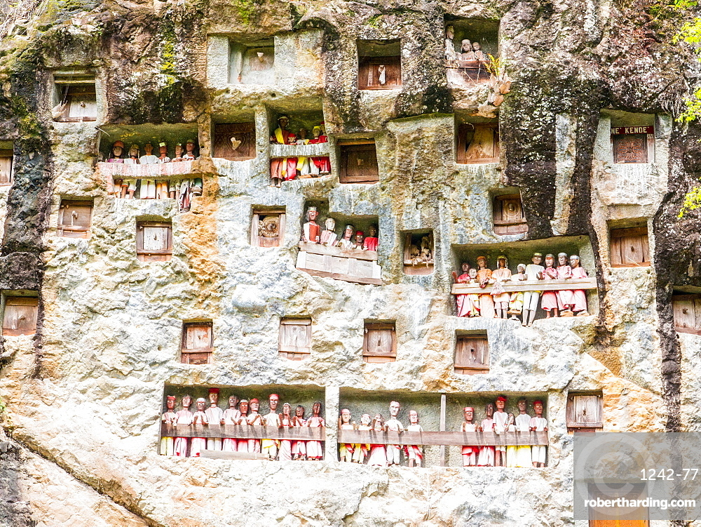 Galleries of tao-taos interspersed with the doors to family crypts, Tana Toraja, Sulawesi, Indonesia, Southeast Asia, Asia