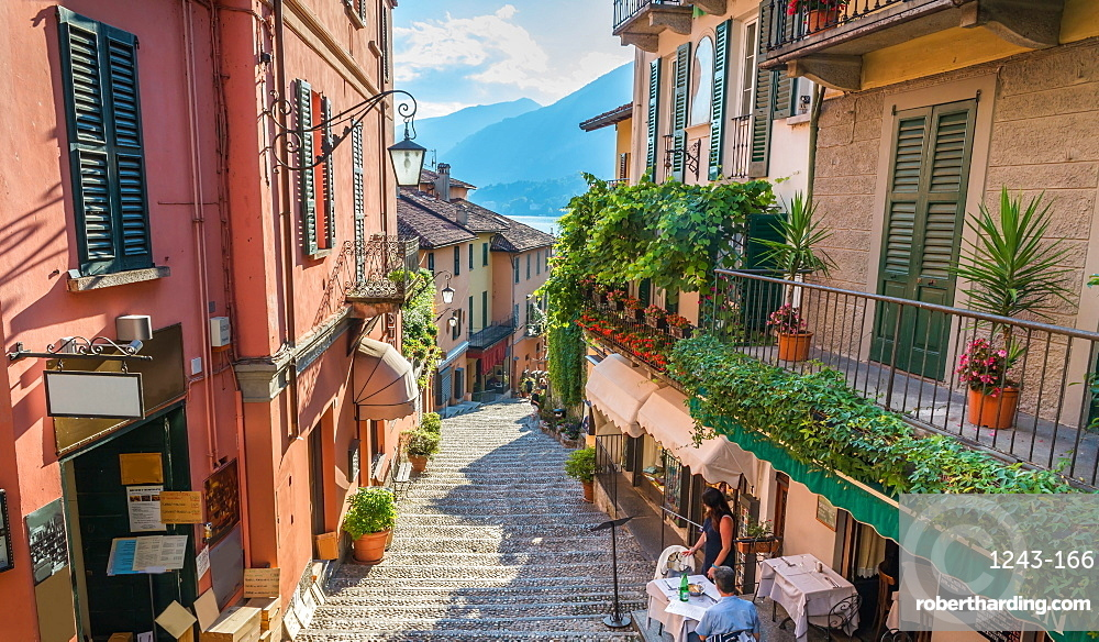 Shops on Salita Serbelloni in the historic old town with the lake in the distance, Bellagio, Lake Como, Lombardy, Italian Lakes, Italy, Europe