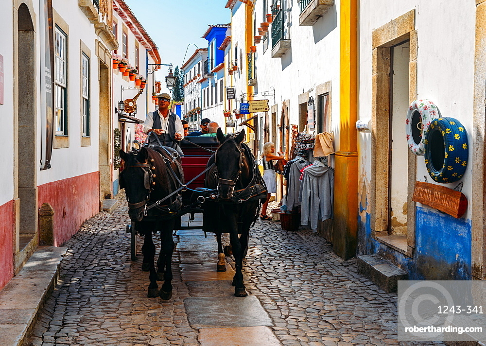Horse-drawn carriage within the ancient fortified village of Obidos, Oeste Leiria District, Portugal, Europe