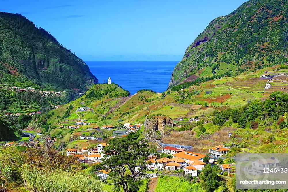 A distant view of Tower Chapel, Capela de Nossa Senhora de Fatima, looking towards Sao Vicente and the Atlantic Ocean, Madeira, Portugal, Atlantic, Europe
