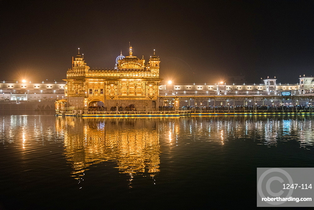 Night time reflections, The Golden Temple, Amritsar, Punjab, India, Asia