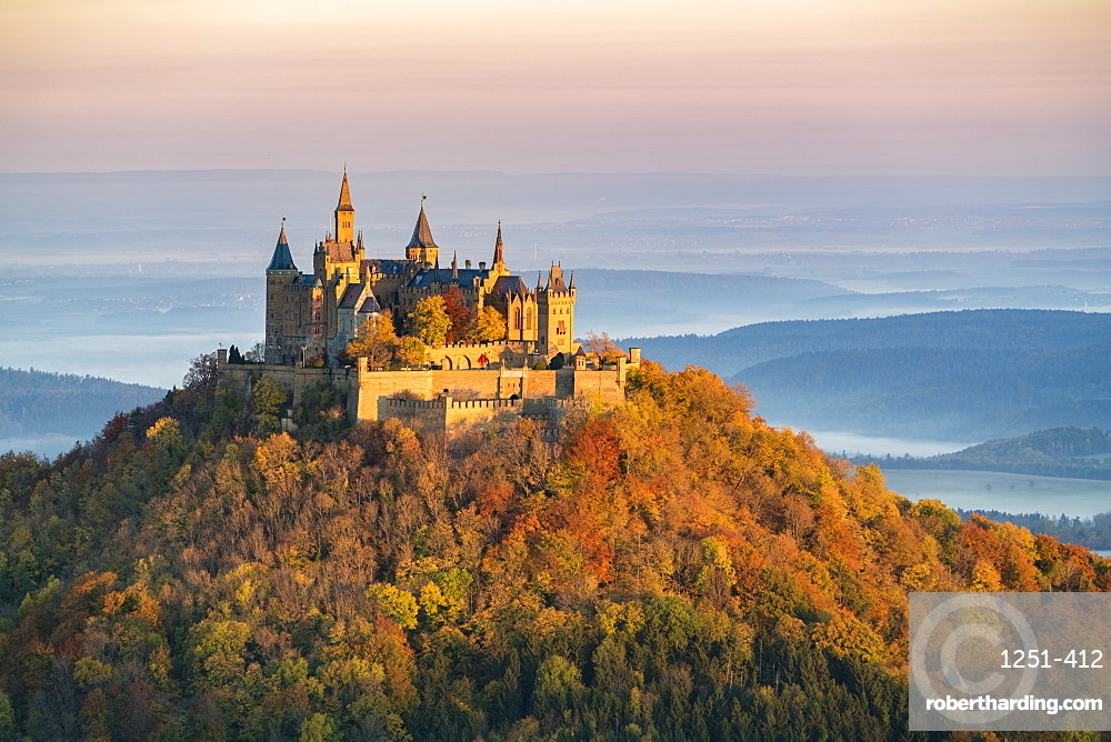 Hohenzollern castle in autumnal scenery at dawn, Hechingen, Baden-Wurttemberg, Germany, Europe