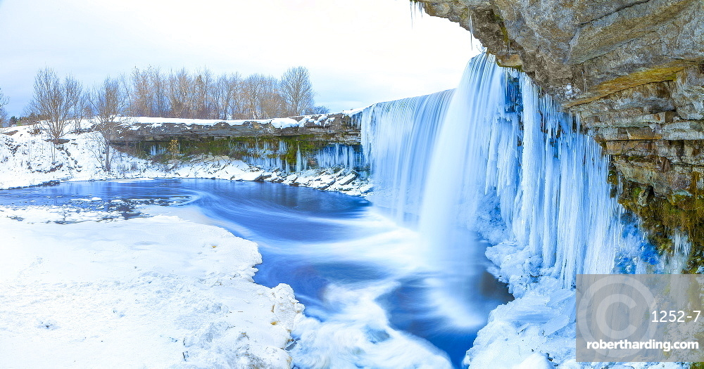 Winter ice covered and snowy waterfall, Estonia, Europe