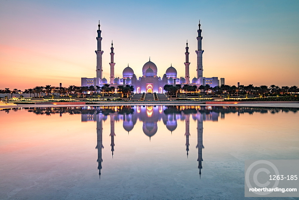 Abu Dhabi's magnificent Grand Mosque viewed in a reflecting pool.