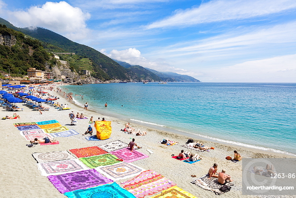 Blanket sellers showcasing their products on the beach at Monterosso, Cinque Terre, Liguria, Italy, Mediterranean, Europe