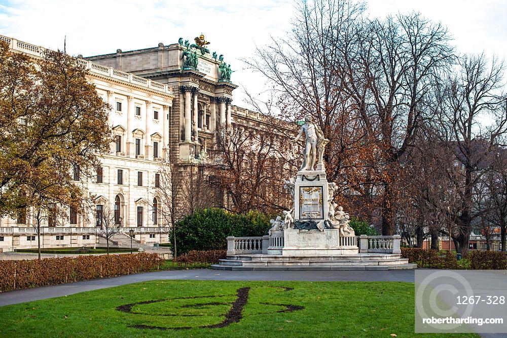 Mozart statue in Burggarten in front of Neue Burg building, part of the Hofburg Palace, Vienna, Austria, Europe