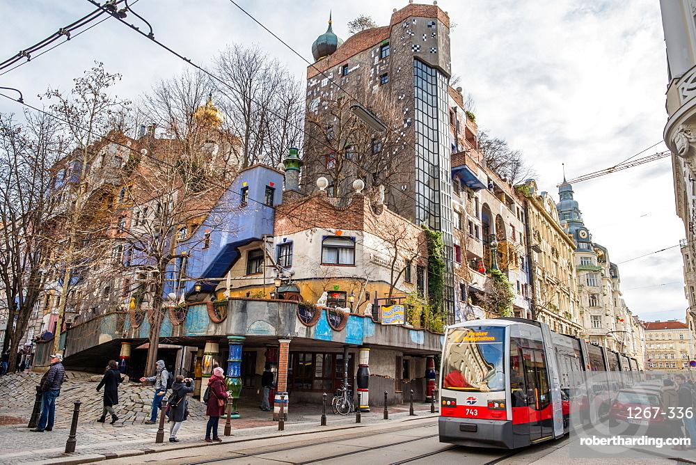 Tram at Hundertwasserhaus, expressionist landmark and public housing, designed by Friedenreich Hundertwasser in Vienna, Austria, Europe
