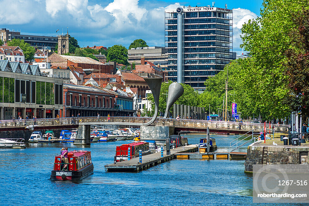 City skyline with canal boats at Pero's Bridge across the Floating Harbour, Harbourside, Bristol, England, United Kingdom