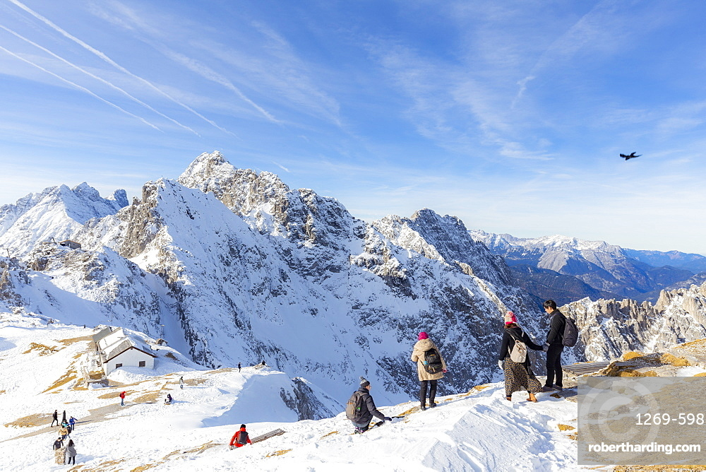 Tourists descends from Hafelekar peak, the top of ski resorts of Innsbruck, Tyrol, Austria, Europe