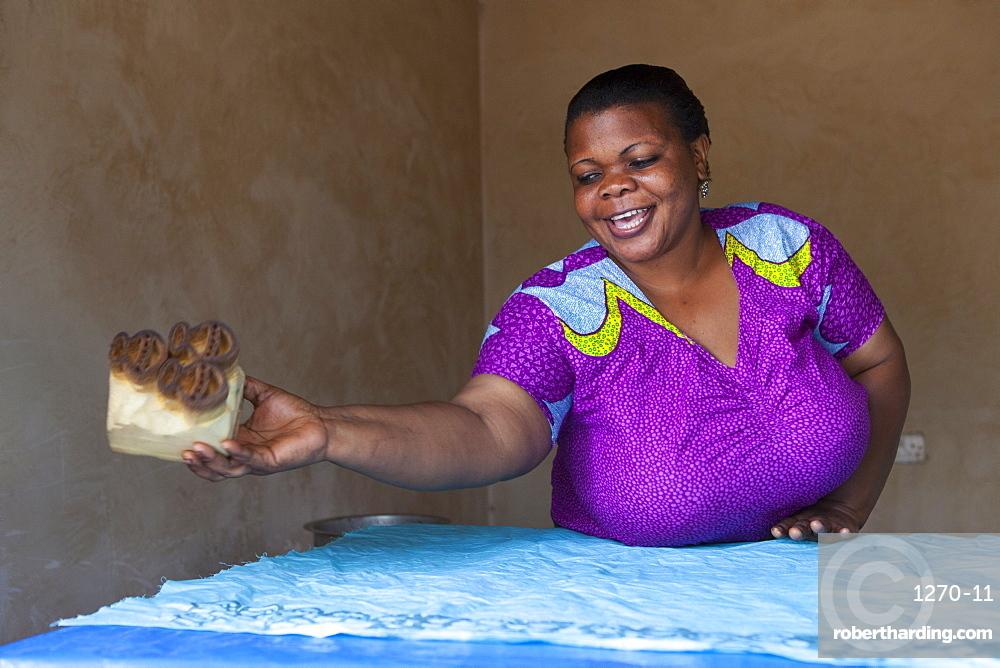A woman making a new batik print, Tanzania, East Africa, Africa