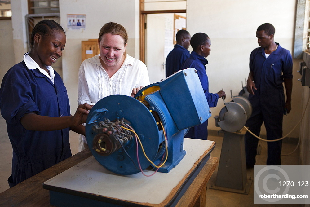 A VSO volunteer teaching a female electrician, Tanzania, East Africa, Africa