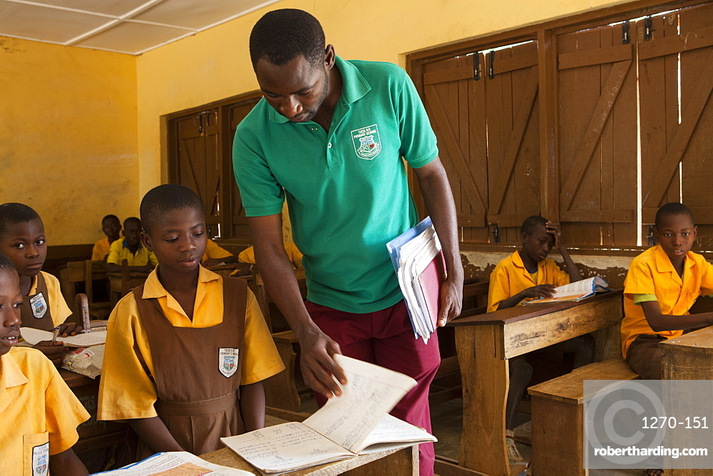 A male teacher teaching a classroom of children at a primary school in Ghana, West Africa, Africa