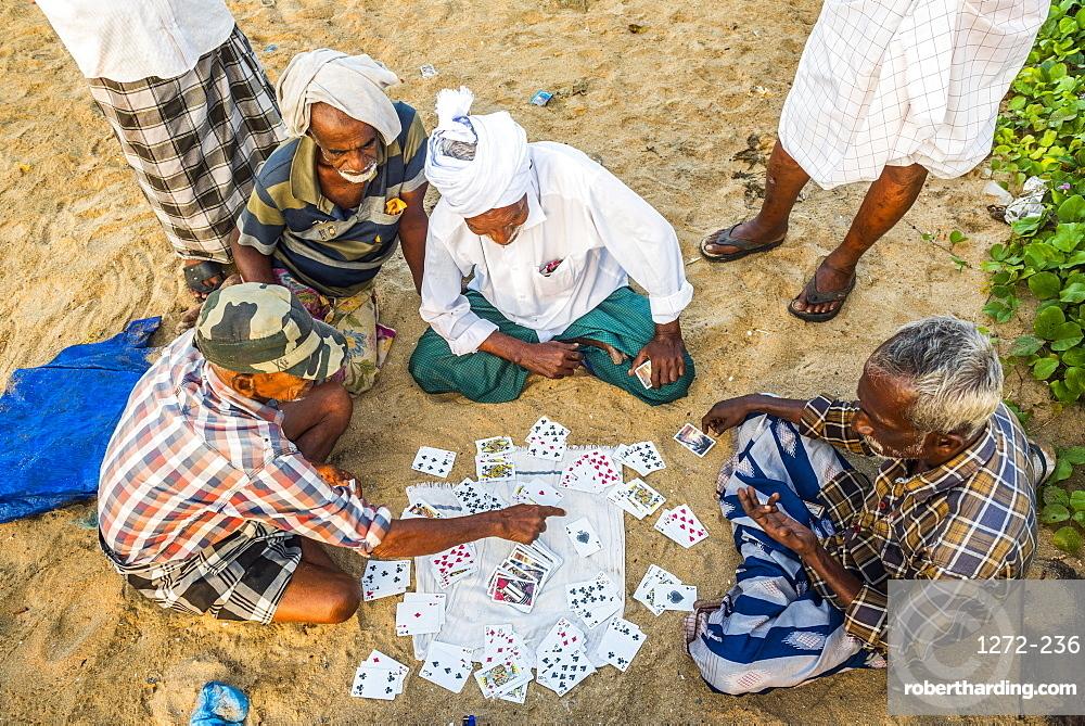 Fishermen playing cards at Kappil Beach, Varkala, Kerala, India, Asia