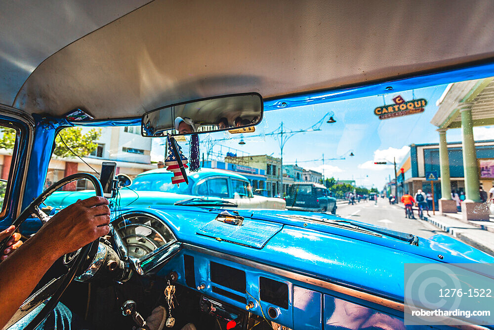 View from taxi in Cienfuegos, UNESCO World Heritage Site, Cuba, West Indies, Caribbean, Central America