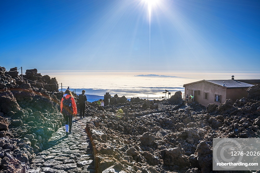 Tourists walking down from top of El Teide volcano to Teide Cable Car in early moning, Tenerife, Canary Islands, Spain, Atlantic, Europe