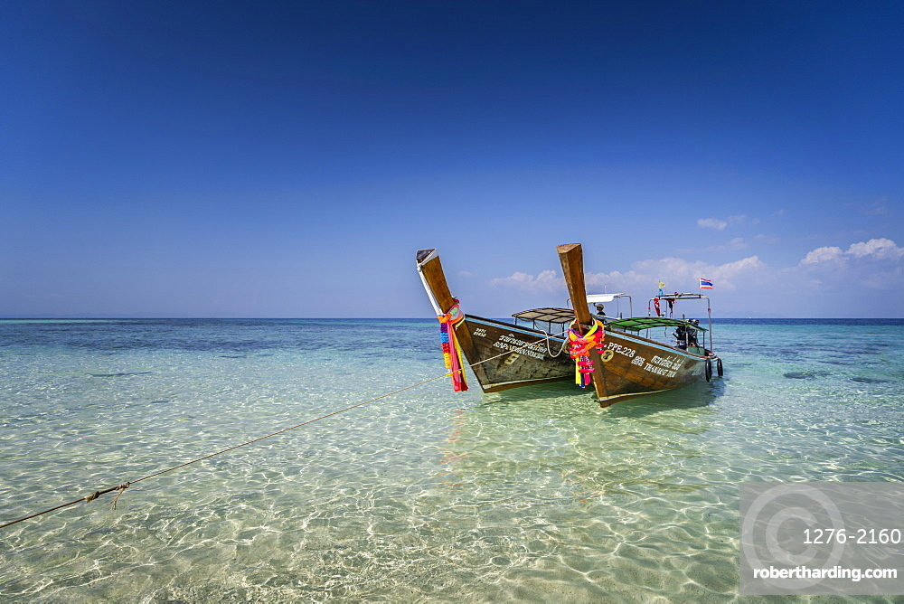 Amazing Blue Water at Bamboo Beach, Maya Bay with long tail boats, Phi Phi Lay Island, Krabi Province, Thailand, Southeast Asia