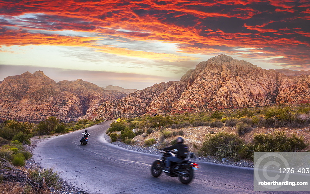 Motocycles driving through The Red Rock Canyon National Recreation Area at sunset, Las Vegas, Nevada, United States of America, North America
