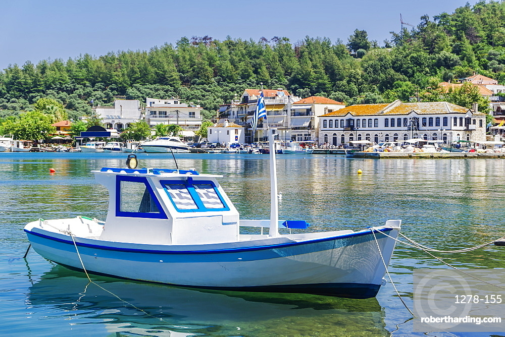 Moored small white boat with Greek flags, Limenas Town, Thassos island, Greek Islands, Greece, Europe