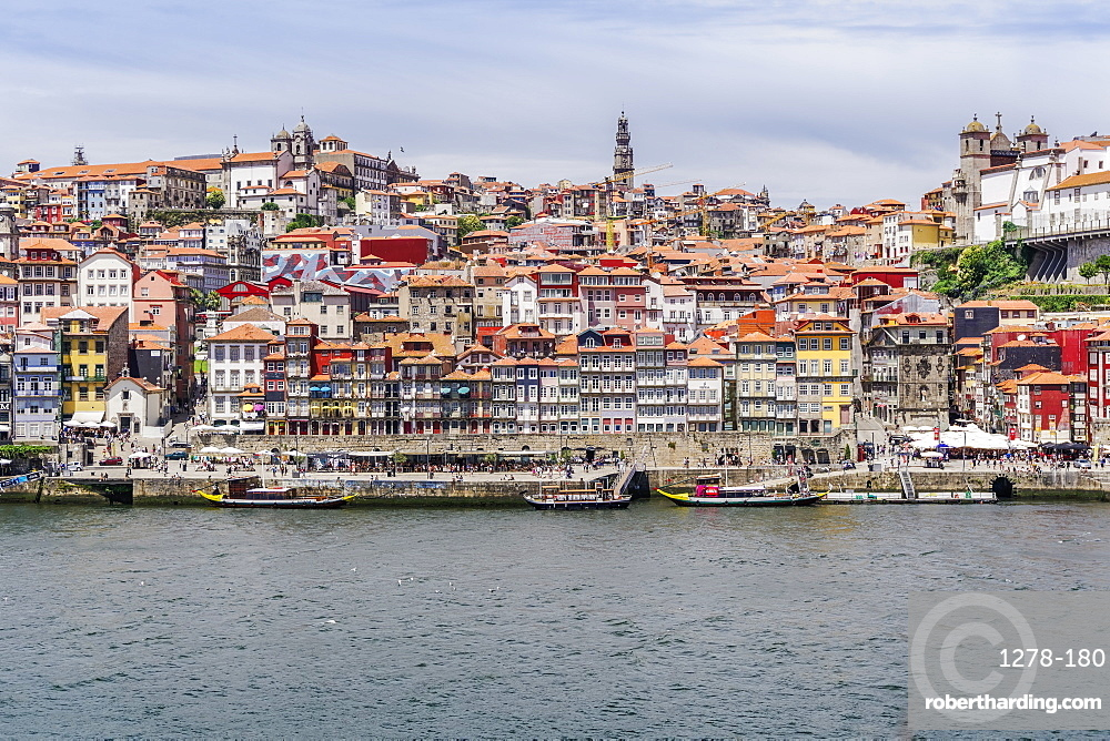 View across the Douro River to Ribeira traditional waterfront houses and moored tourist ships, UNESCO World Heritage Site, Porto, Portugal, Europe
