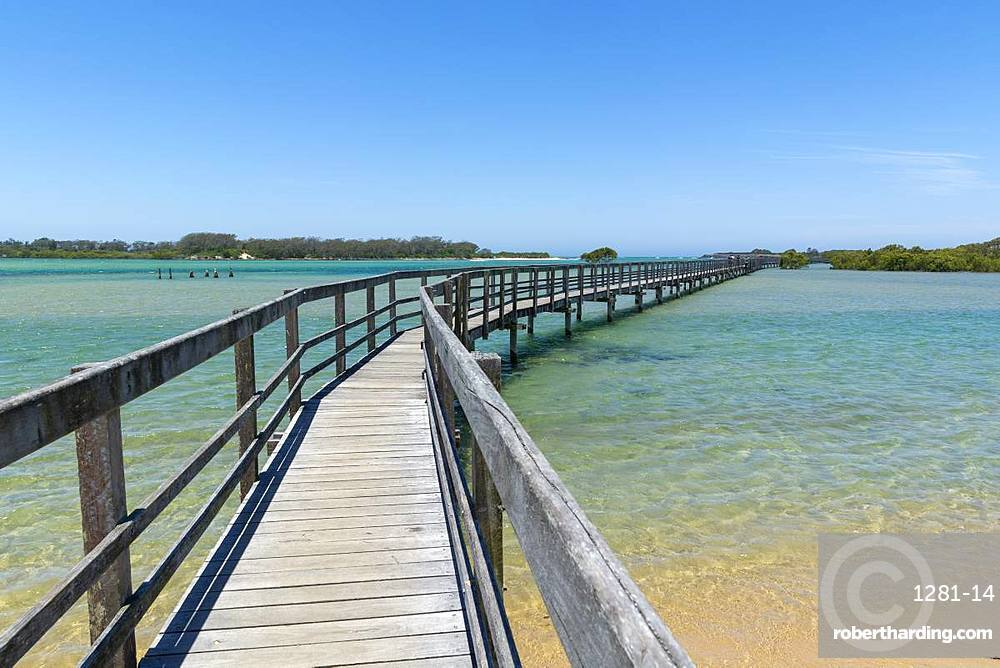 Ocean boardwalk in Urunga on the Coffs Coast stretching along the banks of the Kalang and Bellinger Rivers to the Pacific Ocean, Urunga, New South Wales, Australia, Pacific