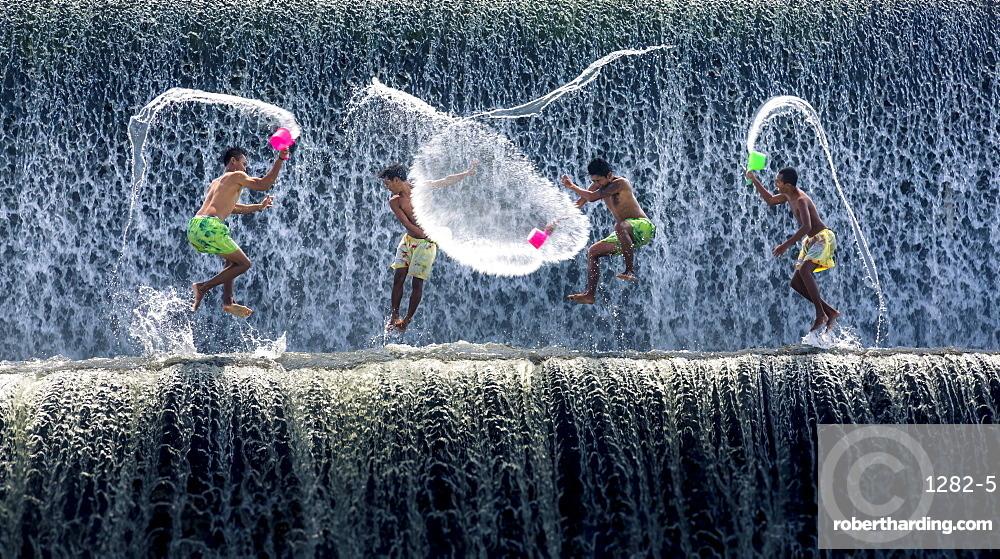 Boys water fight, Tukad Unda dam, Bali, Indonesia, Southeast Asia, Asia
