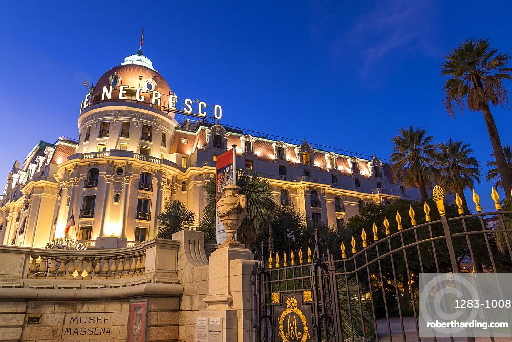 Illuminated Le Negresco Hotel building at dusk, Nice, Cote d'Azur, French Riviera, France, Europe